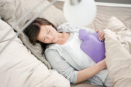 Прогревание яичников грелкой